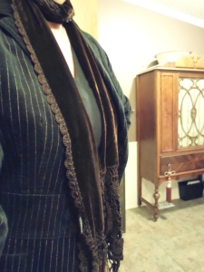 "Thrift store jacket, Jones of New York Sport, $2.30, paired with the $2.10 velvet scarf.  Yeah... Jackets  and scarves aren't really in demand at this time of year, so they're inexpensive.  Cabinet in the background is in my bathroom.  *Freebie  gift from my mother-in-law.  I use it to store towels and linens.  MUCH prettier than one of those ""wire shelf things."""