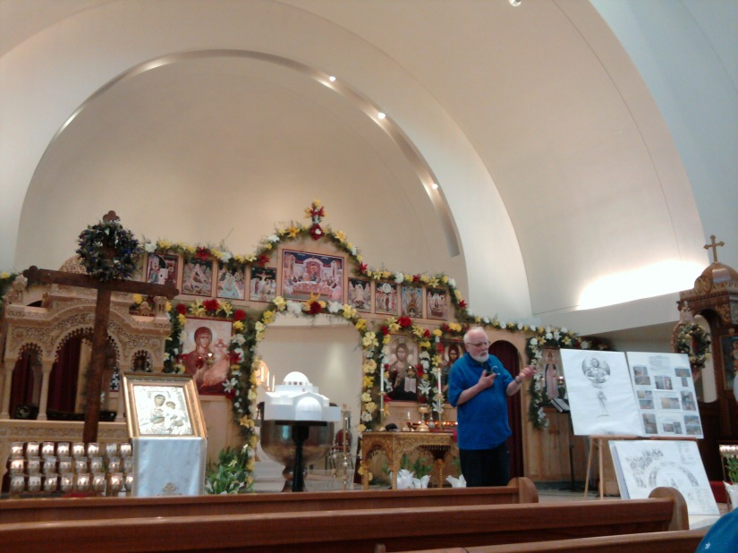 """Our tour guide at Saint Nicholas.  The Iconography behind him are """"temporary"""" pieces."""