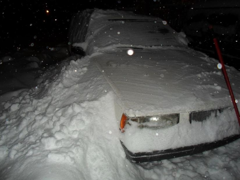 Volvo covered in snow